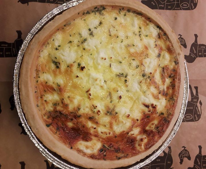 Freshly made quiche, with rosary goats c…